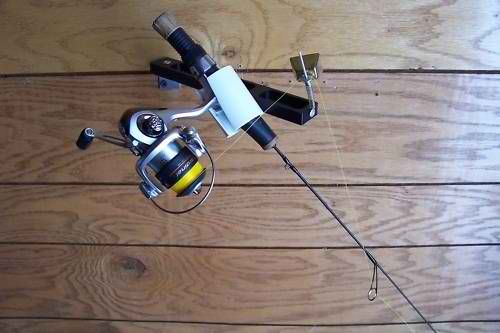 Fish house alarm rod system striker bell